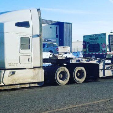 Transport Heavy Equipment Alberta - 4 Seasons Transport & Towing
