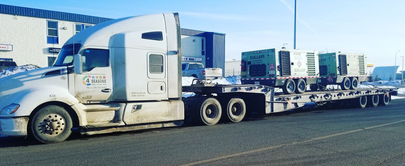 Transport Heavy Equipment Alberta - 4 Seasons Transport & Towing