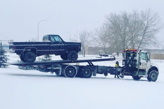 Towing a truck - 4 Seasons Transport & Towing